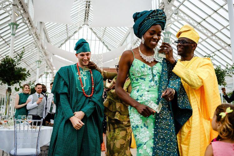 Nigerian money dance in a glasshouse