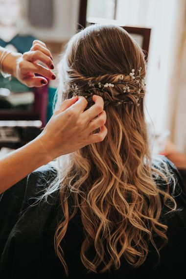Bride with half up half down hair and hair vine