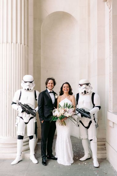 Couple on their wedding day with stormtroopers