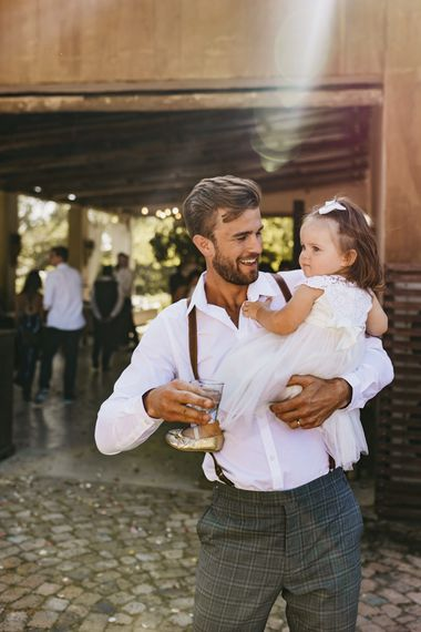 Groom with flower girl at South Africa wedding