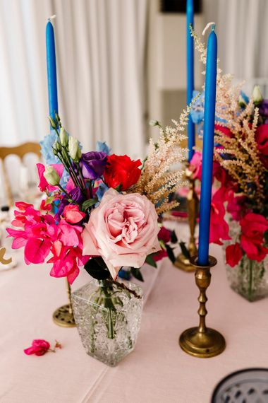 Blue candles and pink flowers for Santorini wedding