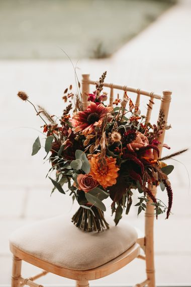 Autumn wedding bouquet with orange wedding flowers