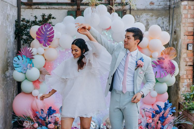 Stylish bride and groom at psychedelic wedding