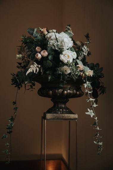 Floral arrangement on gold stand