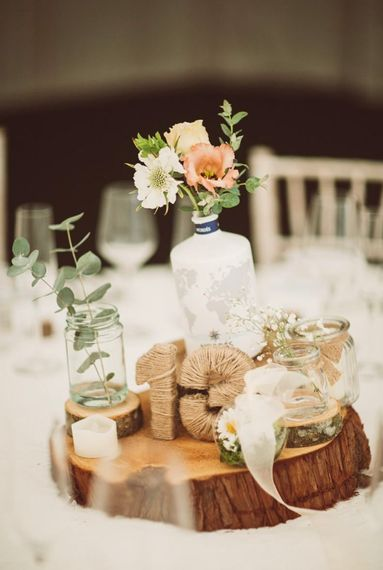 DIY wedding centrepiece with gin bottles
