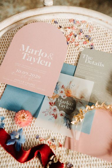 Pastel pink, blue and grey wedding invitations with floral design by Wonderland Invites