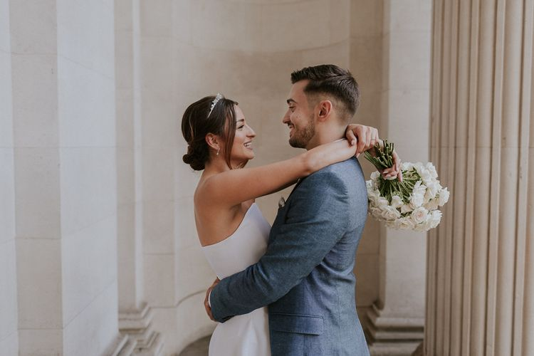 Bride and groom embracing at Old Marylebone Town Hall Wedding