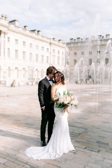 Bride and groom wedding photography by Somerset House water fountains