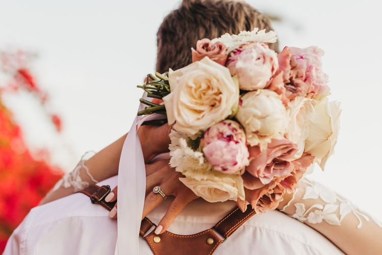 Blush bouquet for bride at wedding