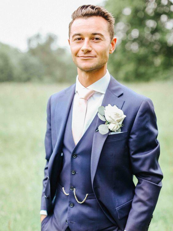 Groom in Navy Charles Tyrwhitt Suit