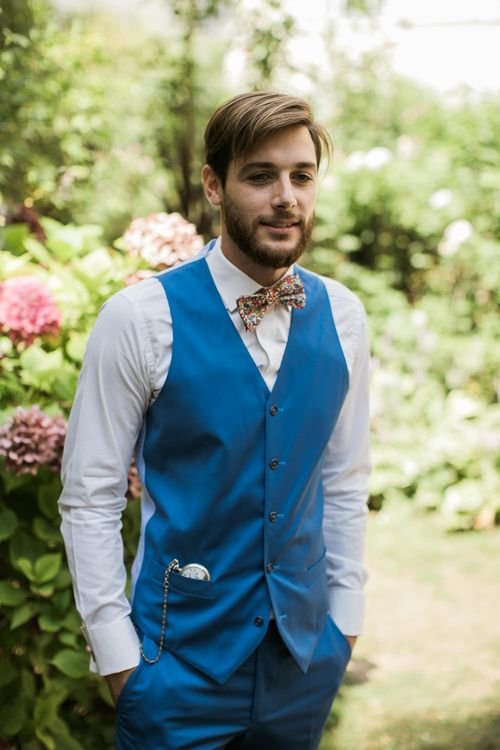 Groom in Blue Waistcoat & Bow Tie