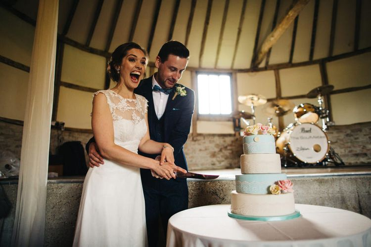 Bride & Groom Cutting the Cake Portrait