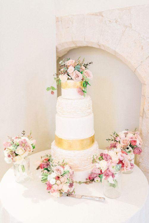 Elegant Wedding Cake with Ruffle Layer