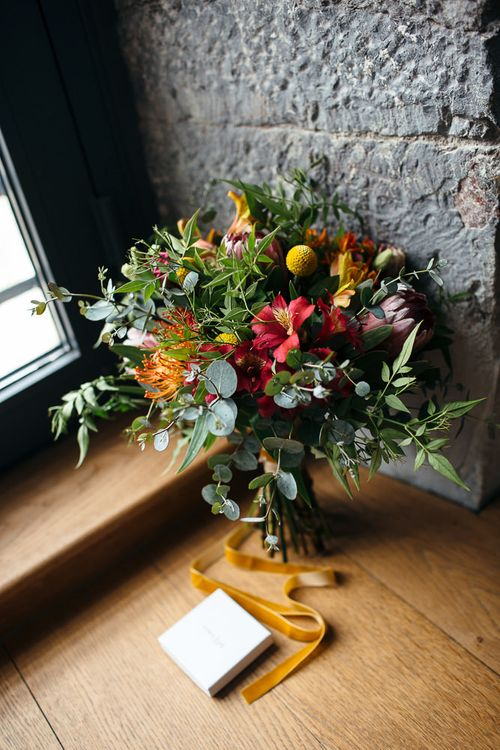 Colourful Red, Orange & Yellow Bouquet with Proteas | Relaxed Industrial Wedding at Ocean Studios, Plymouth | Freckle Photography