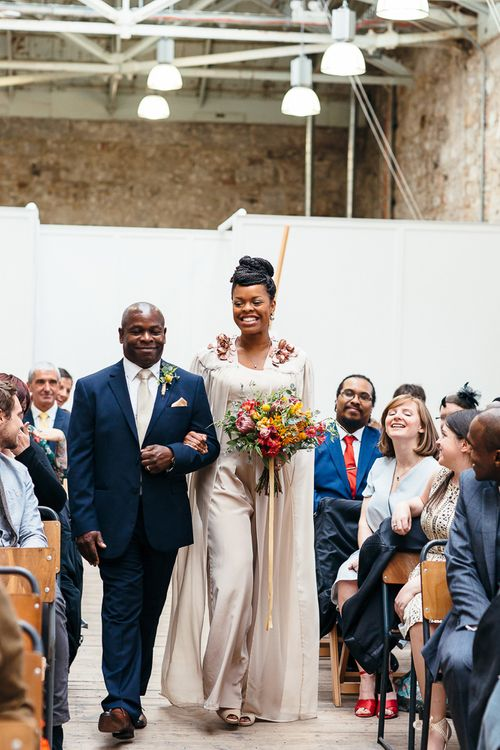Wedding Ceremony | Bride in Bespoke Ailsa Monroe Jumpsuit & Cape | Father of The Bride in Navy Suit | Relaxed Industrial Wedding at Ocean Studios, Plymouth | Freckle Photography