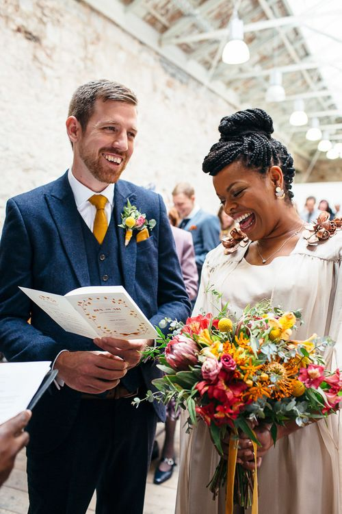 Wedding Ceremony | Bride in Bespoke Ailsa Monroe Jumpsuit & Cape | Groom in Next Navy Wool Suit | Relaxed Industrial Wedding at Ocean Studios, Plymouth | Freckle Photography
