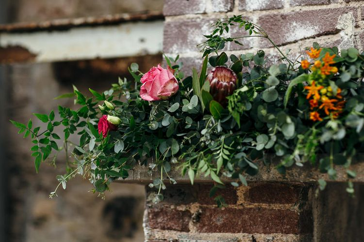 Fireplace Wedding Flower Display | | Relaxed Industrial Wedding at Ocean Studios, Plymouth | Freckle Photography