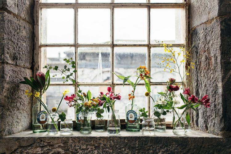 Flower Stems in Bottles | | Relaxed Industrial Wedding at Ocean Studios, Plymouth | Freckle Photography