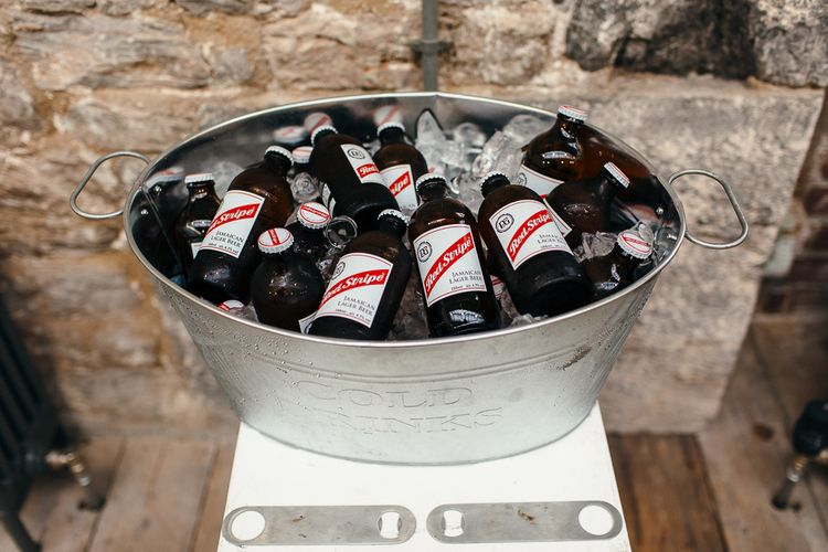 Beer Bottles in Tub | | Relaxed Industrial Wedding at Ocean Studios, Plymouth | Freckle Photography