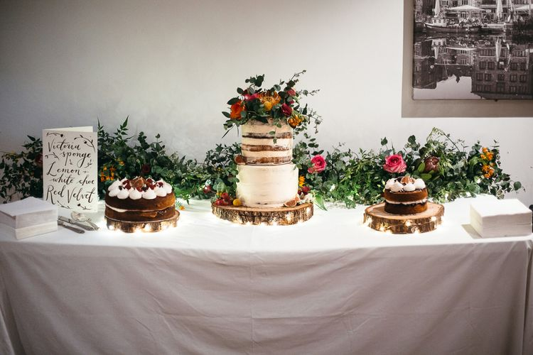 Wedding Cake Table | Floral Cake Topper | Relaxed Industrial Wedding at Ocean Studios, Plymouth | Freckle Photography