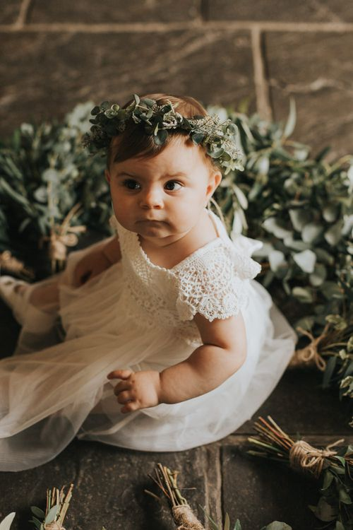 Baby Flower Girl Surrounded by Foliage | Rustic Barn Wedding Reception at Gate Street Barn, Surrey | Kirsty MacKenzie Photography