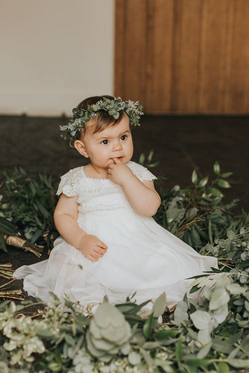 Baby Flower Girl in Flower Crown | Rustic Barn Wedding Reception at Gate Street Barn, Surrey | Kirsty MacKenzie Photography
