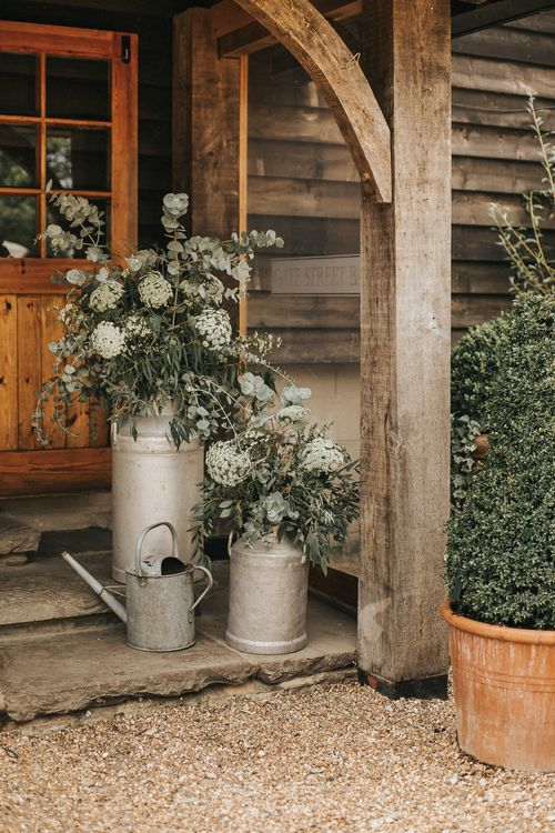 Milk Churn Wedding Flowers & Foliage | Rustic Barn Wedding Reception at Gate Street Barn, Surrey | Kirsty MacKenzie Photography