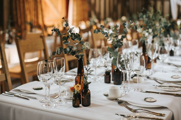 Brown Bottle & Greenery Stem Wedding Decor | Rustic Barn Wedding Reception at Gate Street Barn, Surrey | Kirsty MacKenzie Photography