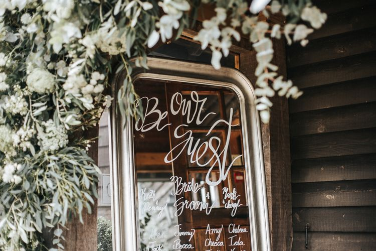Gold Mirror Table Plan with Floral Garland Decor | Rustic Barn Wedding Reception at Gate Street Barn, Surrey | Kirsty MacKenzie Photography