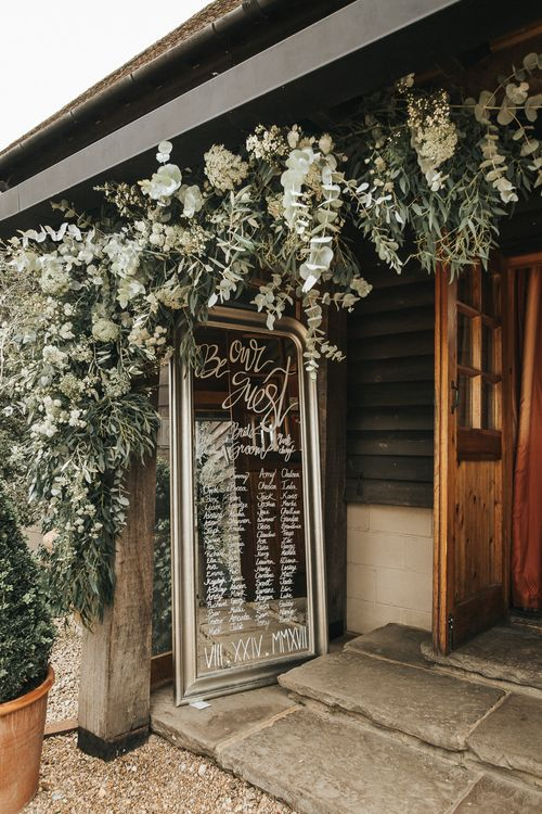 Large Gold Mirror Table Plan | Rustic Barn Wedding Reception at Gate Street Barn, Surrey | Kirsty MacKenzie Photography