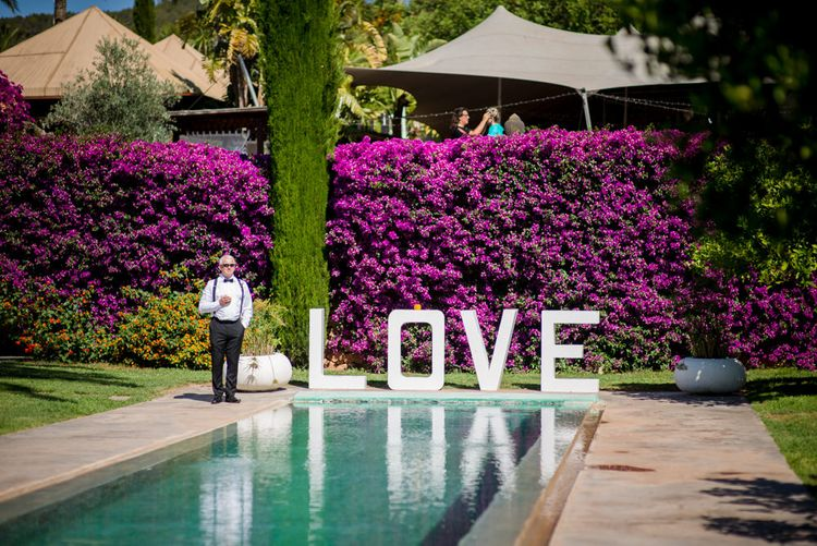 Giant LOVE Sign | Outdoor Ibiza Destination Wedding | Gypsy Westwood Photography | Infin8 Film