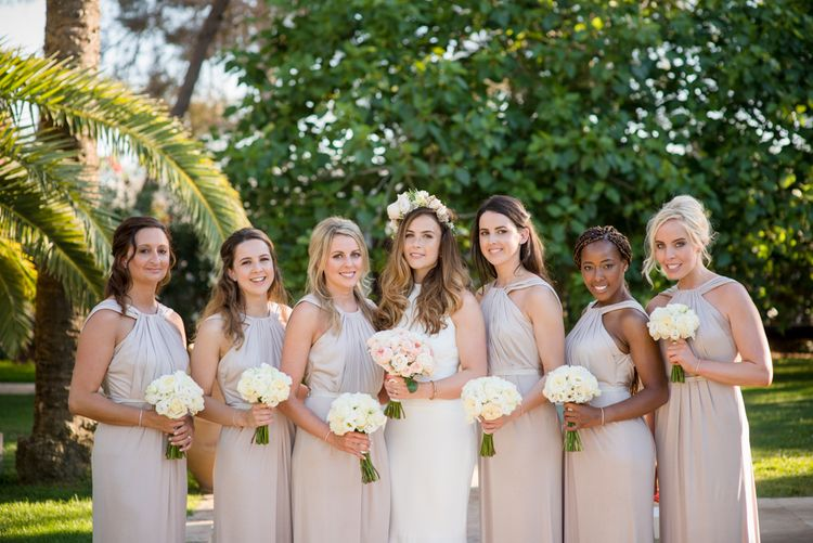 Bridesmaids in Pink Kelsey Rose Dresses | Bride in Suzanne Neville Wedding Dress | Outdoor Ibiza Destination Wedding | Gypsy Westwood Photography | Infin8 Film