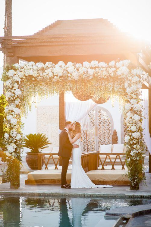 Floral Arbour | Bride in Suzanne Neville Wedding Dress | Groom in Reiss Suit | Outdoor Ibiza Destination Wedding | Gypsy Westwood Photography | Infin8 Film