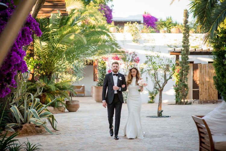 Bride in Suzanne Neville Wedding Dress & Flower Crown | Groom in Reiss Suit | Outdoor Ibiza Destination Wedding | Gypsy Westwood Photography | Infin8 Film