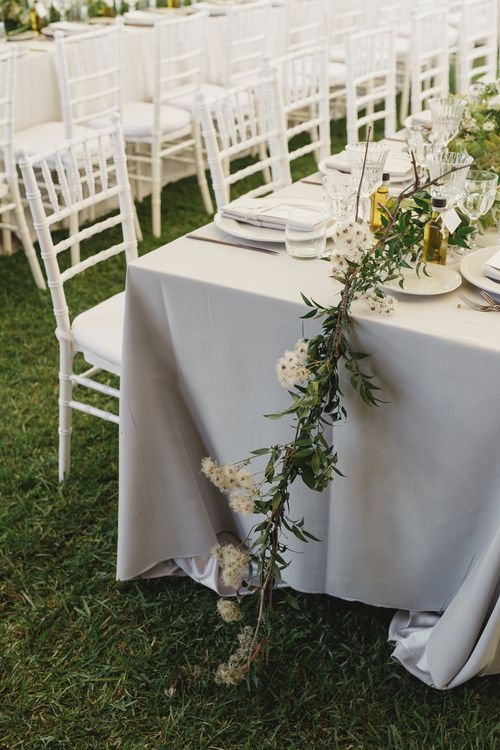 Elegant Tablescape with Gold Flatware & Greenery Table Runner