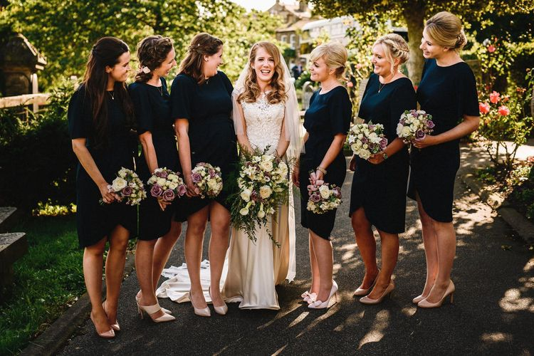 Bride in Lace & Satin Justin Alexander Wedding Dress with Bridesmaids in Navy Dresses | Andy Gaines Photography