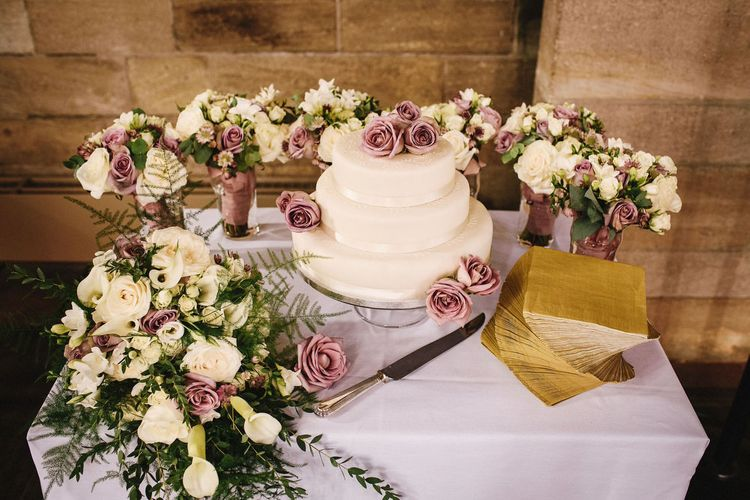 Traditional Royal Icing Wedding Cake with Lilac Flower Decor