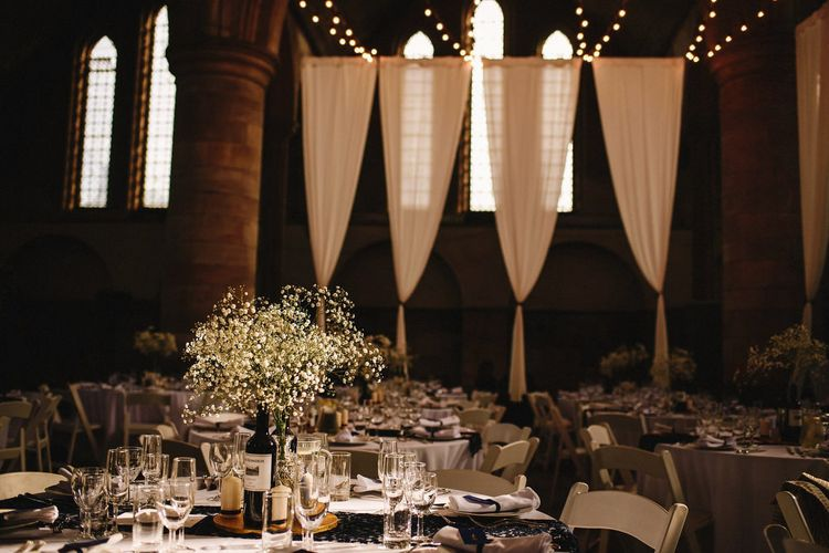 Draped Left Bank, Derelict Church Wedding Venue in Leeds | Gypsophila in Bottles Table Centrepieces | Andy Gaines Photography