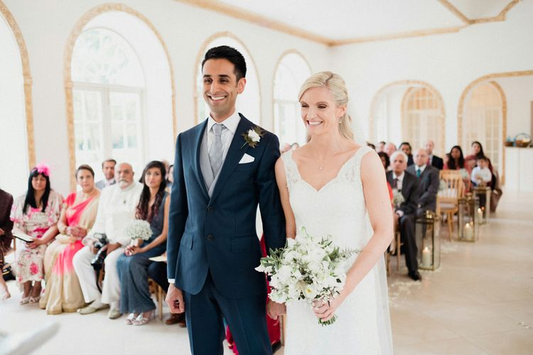 Lace Lusan Mandongus Wedding Dress | Groom in Suit Supply | English & Asian Wedding at Northbrook Park | Claudia Rose Carter