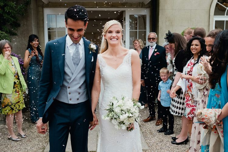 Bride in Lusan Mandongus Wedding Dress | Groom in Suit Supply Tails | English & Asian Wedding at Northbrook Park | Claudia Rose Carter