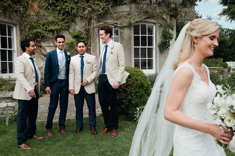 Groom in Navy Suit Supply | Groomsmen in Beige Reiss Jacket | English & Asian Wedding at Northbrook Park | Claudia Rose Carter
