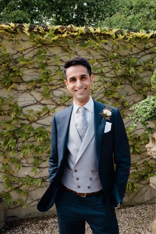 Groom in Suit Supply | English & Asian Wedding at Northbrook Park | Claudia Rose Carter