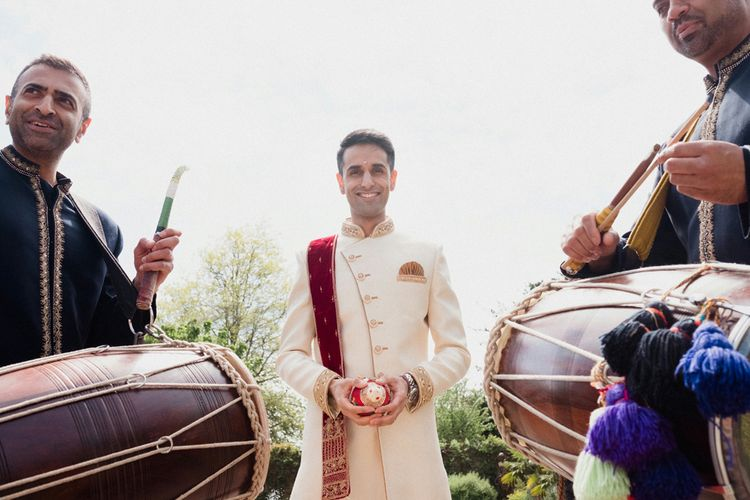 Groom in Traditional Indian Dress | English & Asian Wedding at Northbrook Park | Claudia Rose Carter