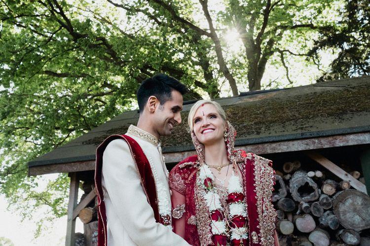 Bride & Groom in Traditional Hindu Attire | English & Asian Wedding at Northbrook Park | Claudia Rose Carter