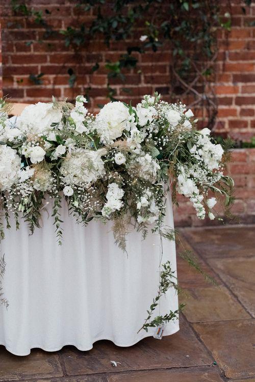 White Floral Arrangement | English & Asian Wedding at Northbrook Park | Claudia Rose Carter