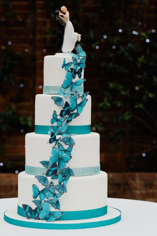 Traditional Wedding Cake with Butterfly DecorWhite Floral Arrangement | English & Asian Wedding at Northbrook Park | Claudia Rose Carter