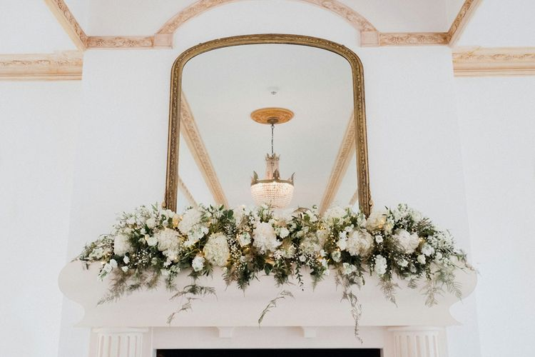 Mantle Piece Wedding Flowers | English & Asian Wedding at Northbrook Park | Claudia Rose Carter