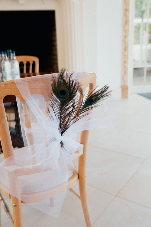 Peacock Feather Chair Decor | English & Asian Wedding at Northbrook Park | Claudia Rose Carter