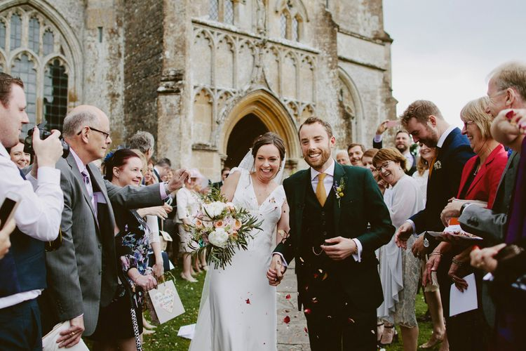 Confetti Moment | Bride in Rose & Delilah Gown | Groom in Donegal Green Wool Three Piece Suit from Beggars Run | David Jenkins Photography | Confetti & Silk Films