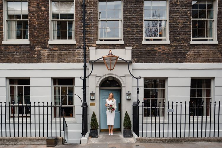 Bride in Pleats Please Issey Miyak Dress | Chic London Wedding at St Bartholomew the Great Church & St John Bar & Restaurant | Helen Abraham Photography